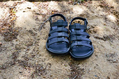 Pair of Sandals on the sand. Pair of Sandals on a sand ground Stock Photo