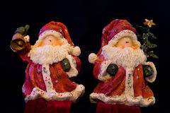 Pair of Santa figurines Royalty Free Stock Photos