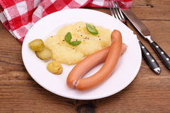 Pair of sausage with mashed potatoes, mustard Royalty Free Stock Image