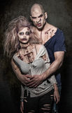 A pair of scary evil zombies. A bloody pair of scary evil zombies royalty free stock photos