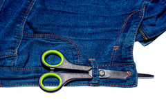 Pair of scissors and blue jeans and zipper isolated on white background Stock Photo