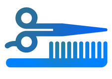 Pair of scissors and a comb Stock Photo