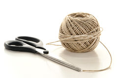 Pair of Scissors and Spool of Natural Twine String Stock Images