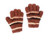 Pair of scruffy brown woolen kid's winter gloves isolated on white. A pair of small scruffy brown and striped woolen kid's winter gloves isolated on white Royalty Free Stock Images