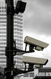 Pair of security cameras. On black and white background Stock Photos