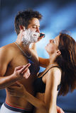 Pair during a shaving. A young pair during a shaving stock photography