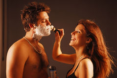 Pair during a shaving Royalty Free Stock Photo
