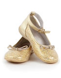 Pair of shiny golden shoes for girls Royalty Free Stock Photos