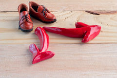 A pair of shoe standing with red arrow symbol Stock Image