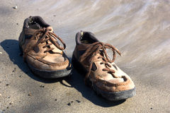 Pair of shoes 3. Lonely pair of shoes on a lakeshore send Royalty Free Stock Photo
