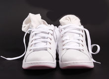 A pair of shoes. Against black background Royalty Free Stock Photos