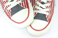 Pair of shoes with american stars and stripes decoration Stock Photography