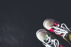 Pair of shoes arranged on the bottom right corner for this shot. Royalty Free Stock Photos