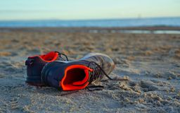 A pair of shoes on beach sand royalty free stock photography