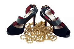Pair shoes and beads. Isolated royalty free stock image