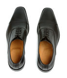 Pair Of Shoes. Pair of black elegant man shoes isolated on white background royalty free stock photos