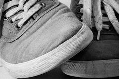 Pair of shoes crossed in B and W Royalty Free Stock Photography