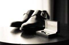 Pair of shoes and cuff links. A pair of shoes and cuff links ready to be used in a wedding Stock Image