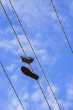 A pair of shoes on Electro wire tower Royalty Free Stock Photos