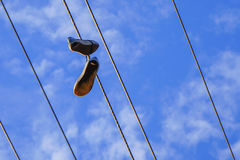 A pair of shoes on Electro wire tower Stock Photography