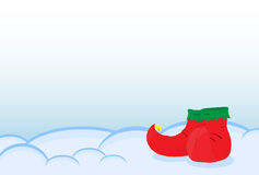 A pair of shoes elf standing on the snow. Greeting Card Merry Ch Stock Photo