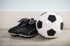 Pair Of Shoes With Football Stock Image