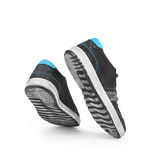 A pair of shoes in a jump Royalty Free Stock Photos