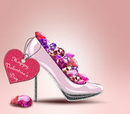 Pair of shoes with label and diamonds Stock Image