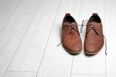 Pair of shoes with laces tied together Royalty Free Stock Photo