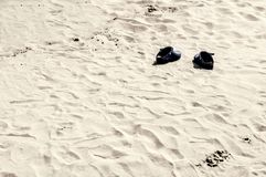 Pair of shoes on the beach royalty free stock photography