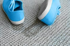 Pair of shoes with mud. On carpet Stock Photo