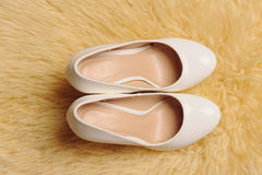 Pair of Shoes on Puffy Carpet Royalty Free Stock Image