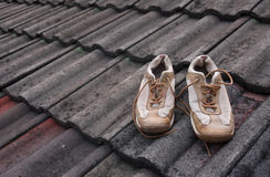 A pair of shoes on the roof Royalty Free Stock Photos