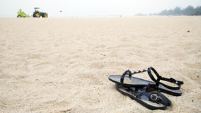 Pair of shoes on sand Stock Photography