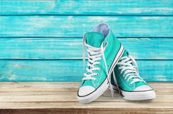 Pair of new blue gum shoes. Pair shoes sport blue background object nobody stock photos