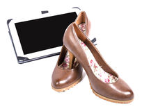 Pair of shoes of woman with digital tablet Stock Photos