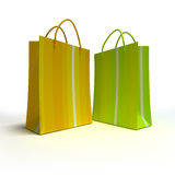 Pair of shopping bags in green and yellow Royalty Free Stock Image