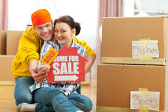 Pair showing home for sale sign with sold sticker Stock Photography