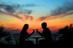 Pair silhouette is held by goblet. The pair silhouette is held by goblet on a sundown Stock Photos