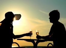 Pair silhouette sit at a table Royalty Free Stock Photo