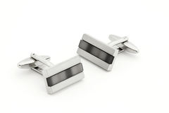 Pair of silver cuff links over white Stock Photo