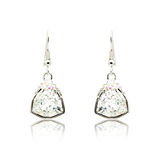Pair of silver diamond earrings isolated on white Stock Photos