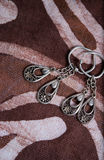 A pair of silver earings. This pair of silver earings is more than 15 years but still looks cool Royalty Free Stock Images