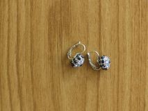 A Pair of Silver Earrings Encrusted with Sapphire Stones. royalty free stock image