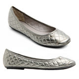 Pair of silver female shoes. Pair of silver female summer shoe on white background royalty free stock photo