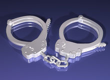 Pair of silver handcuffs Stock Photo