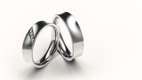 Pair of silver rings with small diamonds for lovers Royalty Free Stock Photo