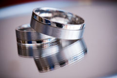A pair of silver wedding rings Royalty Free Stock Images