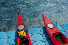 A pair of single kayaks in a row 01 Royalty Free Stock Images