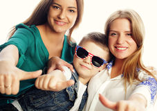 A pair of sisters and little brother Stock Images